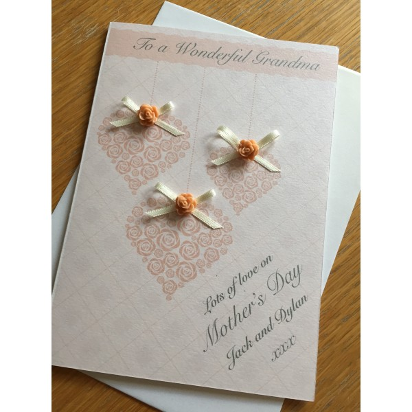 Hanging Hearts Peaches and Cream Bows Mother's Day card